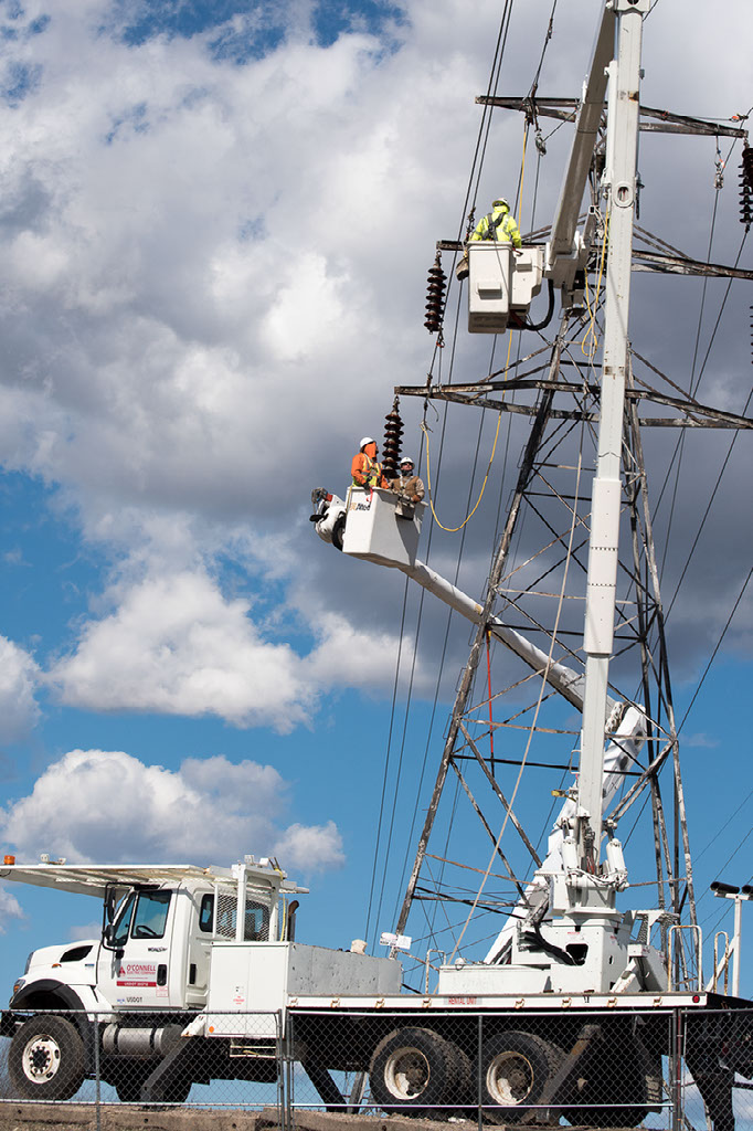 NEAT apprentices work on transmission tower