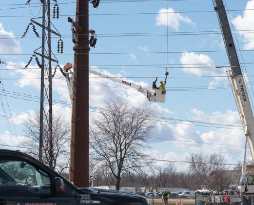 Outside lineman working on H-frame transmission systems