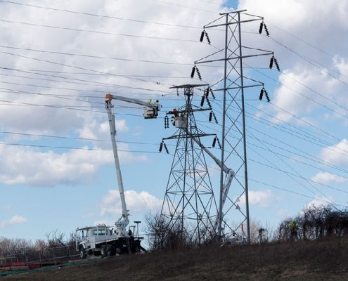 Outside lineman work on high-voltage system